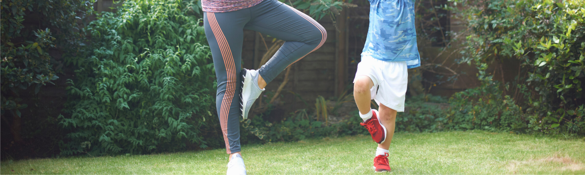 mother and son exercising in a garden