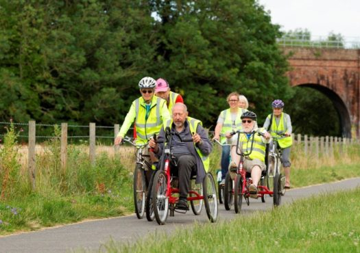 Group of cyclists riding adapted bicycles