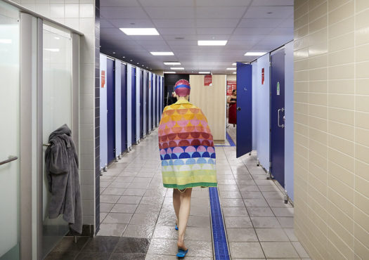 Woman in swimming pool changing rooms