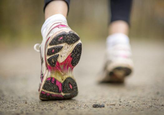 Closeup of a runner running in a park
