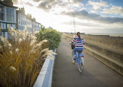 Female cycling in Whitstable