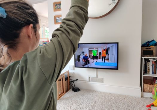 Woman doing an exercise class at home