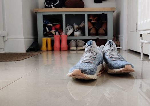 Pair of trainers in a hallway