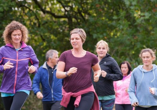 Running group with female lead