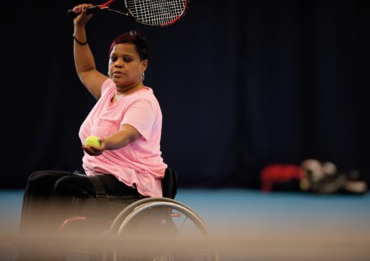 A woman playing wheelchair tennis